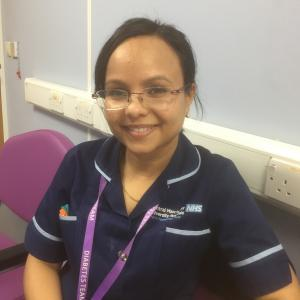 A picture of Nazia in her nursing uniform